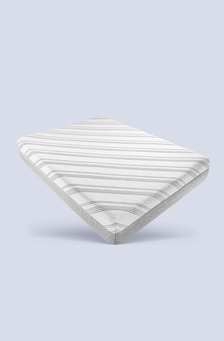 Mattress with striped mattress cover on white and grey background